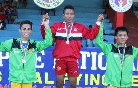 Faulan (center) won two golds during the PNG VQL